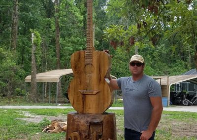 wood-guitar-carving